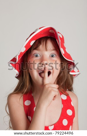 girl fooling around and point the finger to be quiet - stock photo