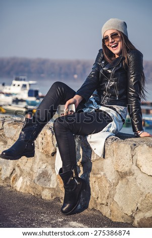 Girl fooling around by the river - stock photo