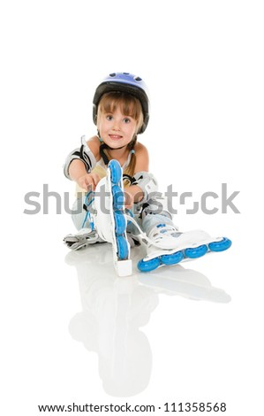 girl four years old with roller and gear resting - stock photo