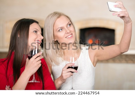 Girl friends are enjoying  the evening, photographed in memory - stock photo