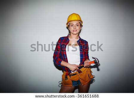 Girl from repair service - stock photo