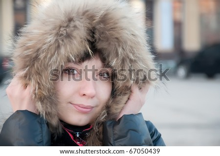 girl frozen in a cap with fur - stock photo