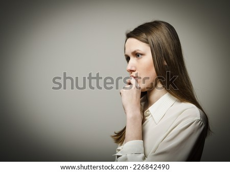 Girl full of doubts and hesitation. Girl is thinking. - stock photo