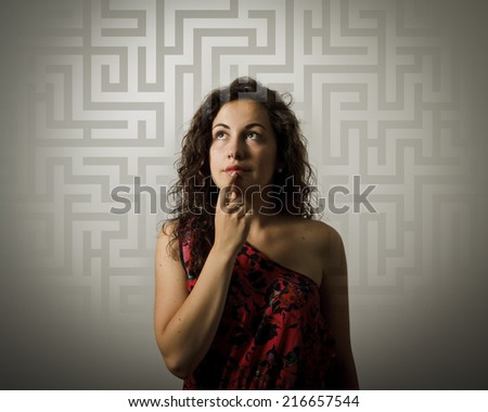 Girl full of doubts and hesitation. Girl looking for the solution. Young woman doing something. - stock photo