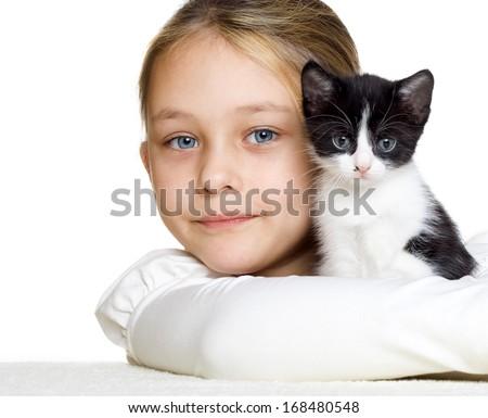 girl gently hugs a kitten - stock photo