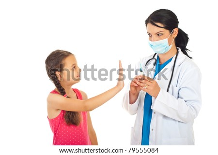 Girl gesturing stop hand to doctor and refuse vaccination  isolated on white background - stock photo