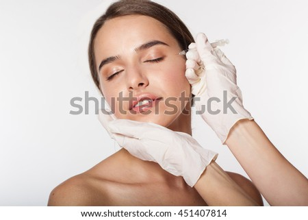Girl getting beauty injection by doctor