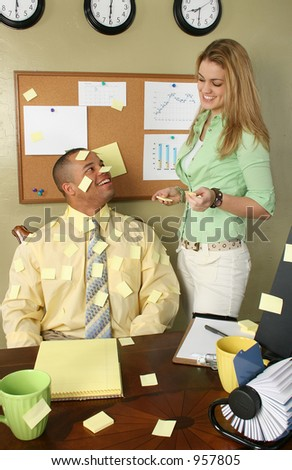 Girl getting covering office worker in yellow stick on note papers.  Blank to add text.  Blank page on cork board to add text.