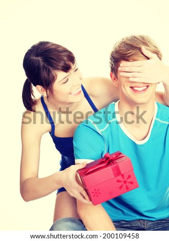 Girl give a gift to her boyfriend - stock photo