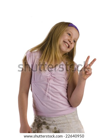 Girl giving peace sign while smiling - stock photo