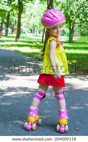 Girl goes rollerblading in the park - stock photo