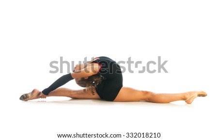 Girl gymnast doing split isolated on white background