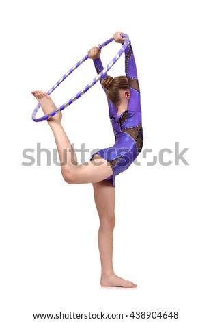 girl gymnast in blue clothes posing with hoop - stock photo