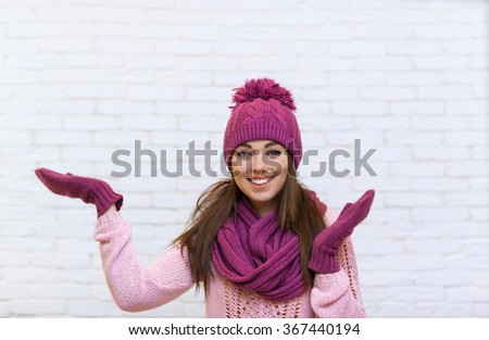 Girl Hand Gesture To Copy Space Attractive Smile Teenage In Pink Hat Over White Brick Background - stock photo