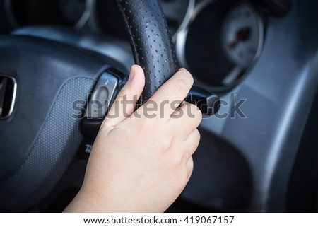 girl hand hold steering wheel, woman drive a car