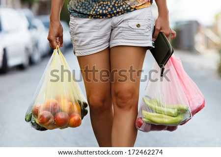 girl hands bag with fresh vegetables - stock photo