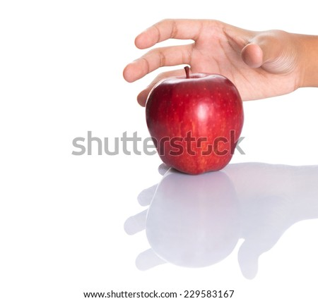 Girl hands reaching for a red apple over white background