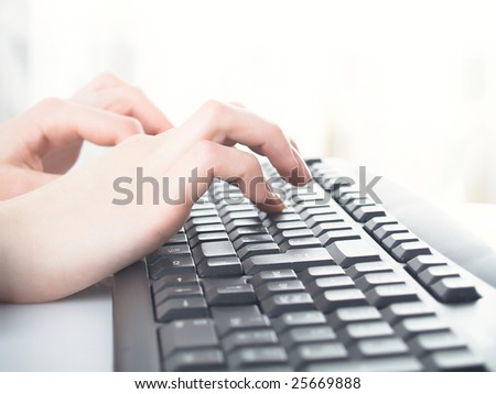 girl hands typing on the background - stock photo