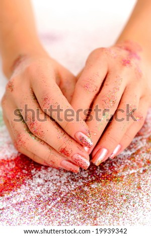 girl hands with shiny eyeshadow on them