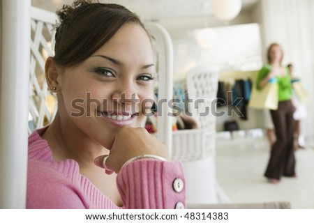 Girl Hanging Out in Boutique - stock photo