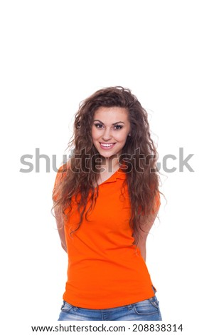 girl happy smile, attractive young excited woman wear orange shirt, isolated over white background - stock photo
