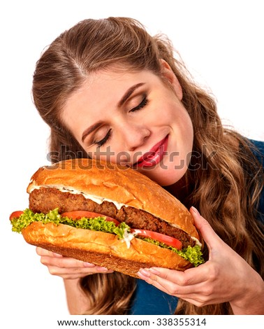 Girl happy smiling and holding big hamburger. Fastfood concept. Isolated. - stock photo