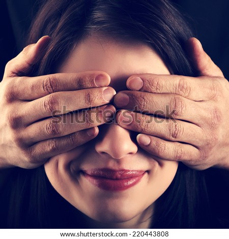 Girl has closed eyes with hands man - stock photo