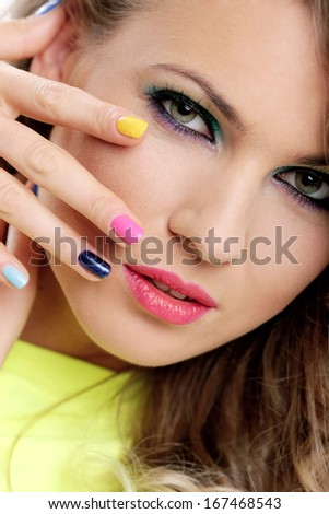 Girl has cute colored nails and makeup