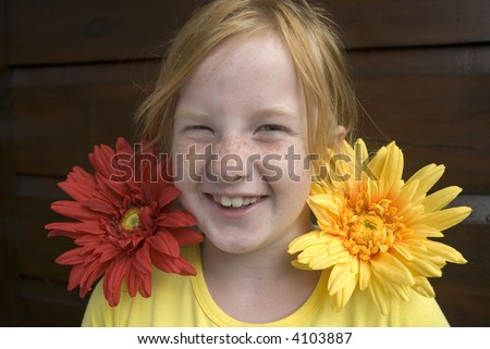 girl has fun with flowers and freckles - stock photo