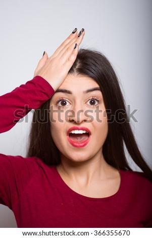 Girl has remembered something isolated - stock photo