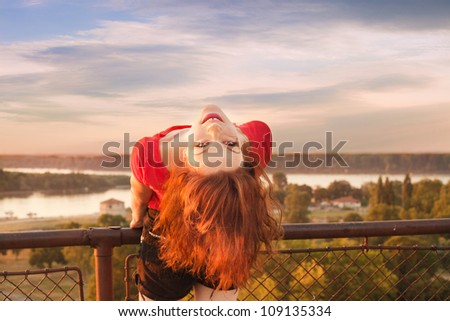 girl have fun on Belgrade Fortress sky, river and city in background summer day - stock photo