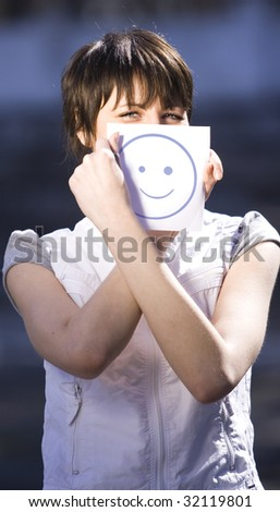 girl have fun with paper smile - stock photo