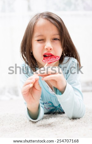 girl have fun with sugar candy