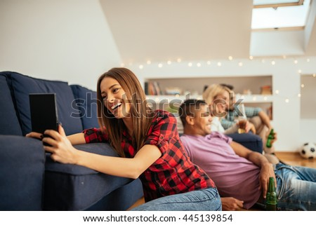 Girl having fun on the internet on a digital tablet. - stock photo