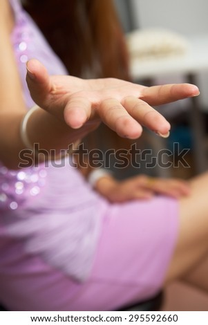 Girl held out her hand and asks for something, maybe money - stock photo