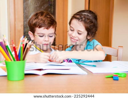 Girl helping a boy with his homework - stock photo