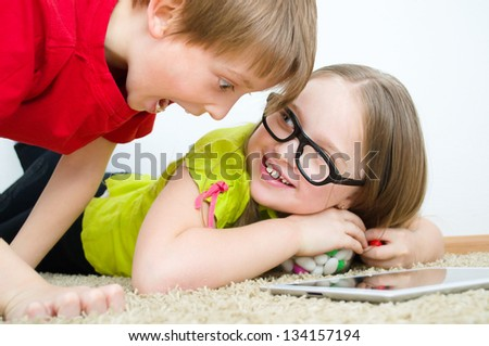 Girl hides colored candies from her brother - stock photo