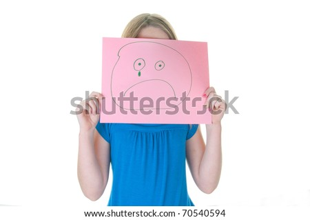 girl hiding behind sad face, part of emotional series - stock photo