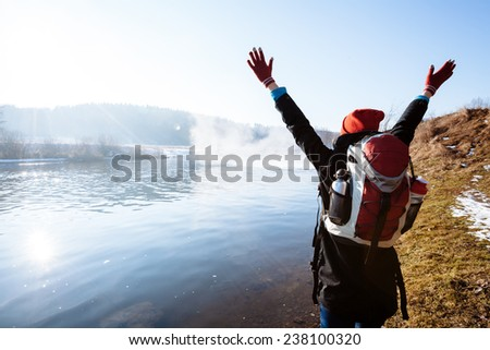 Girl hiking in the nature during sunset - stock photo