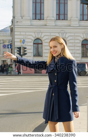 Girl hitchhiking rides and shows stop gesture - stock photo