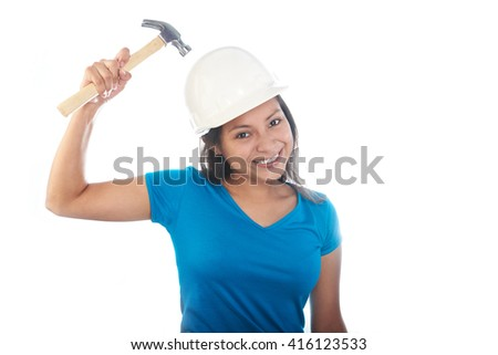 girl hitting her helmet with a hammer