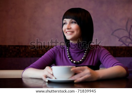 girl hold cup of coffee in hand and laugh - stock photo