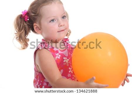 girl holding a balloon - stock photo