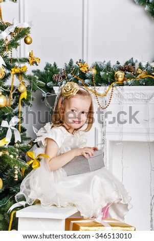 Girl holding a Christmas gift. The concept of celebration and fun. Family happiness. Childhood. 2017 - stock photo