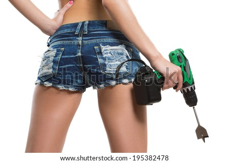 girl holding a drill near the booty. working ass - stock photo
