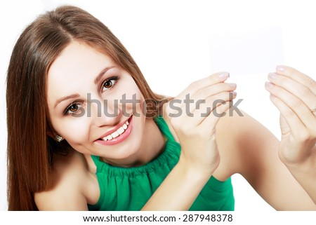 Girl holding a gift card sign. Young beautiful sexy woman showing copy space on empty blank sign or gift card.  - stock photo