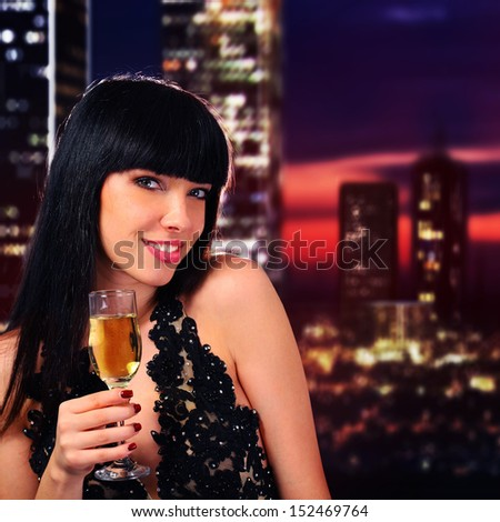Girl holding a glass of champagne - stock photo