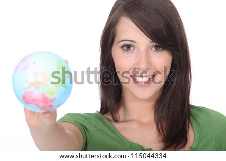 Girl holding  a globe - stock photo