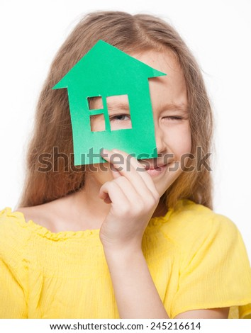 Girl holding a green house. Eco house. Ecology technology - stock photo