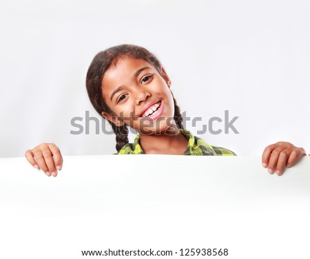 girl holding a large poster - stock photo
